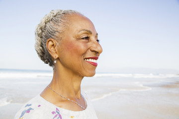 Smiling black woman on beach