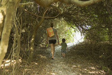Caucasian mother and son walking on path