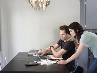 Caucasian couple using laptop