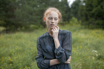 Portrait of Caucasian girl standing in field