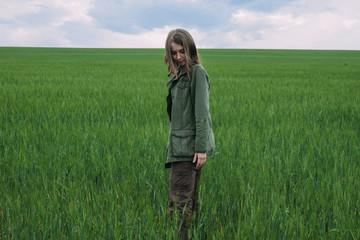 Beautiful woman standing in a grassy field