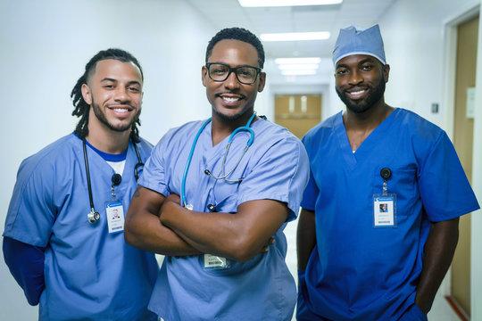 Portrait of smiling male nurses in hospital