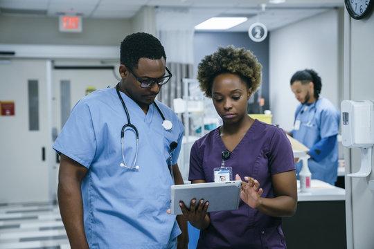 Nurse is using digital tablet in hospital