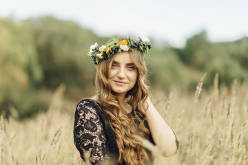 Middle Eastern woman wearing flower crown in field