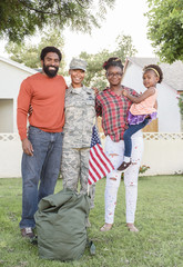 Portrait of black woman soldier with family