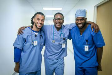 Portrait of smiling male nurses