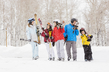 Smiling Caucasian family on skiing vacation