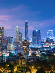 Vertical image of Bangkok urban skyline aerial view at night.