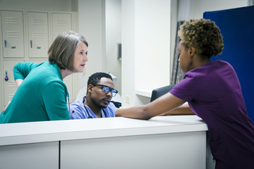 Doctors and nurses talking in hospital