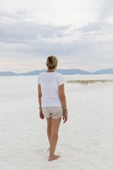 Caucasian woman admiring scenic view of desert