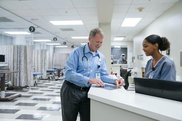 Doctor and nurse using digital tablet