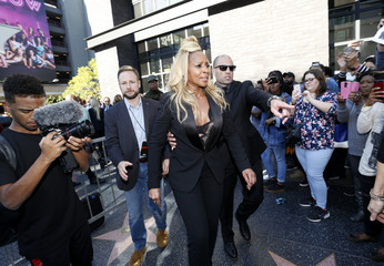 Actress and singer Mary J. Blige departs her star ceremony in Hollywood