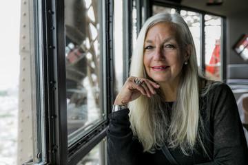 Portrait of smiling Caucasian woman near window