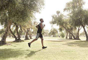 Black man running in park