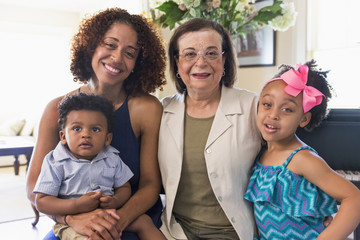 Portrait of smiling mixed race multi-generation family