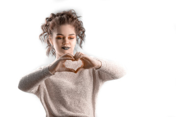 Beautiful curly haired young caucasian woman gesturing heart shape with hands, isolated on white background