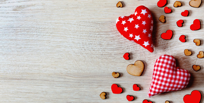 Hearts on a wooden background. Valentine's Day background