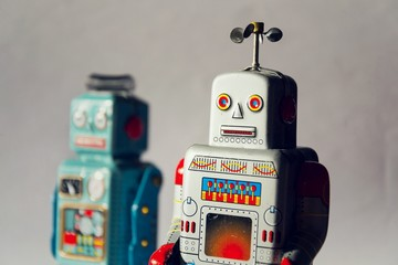 Angry vintage tin toy robots, artificial intelligence, robotic drone delivery concept