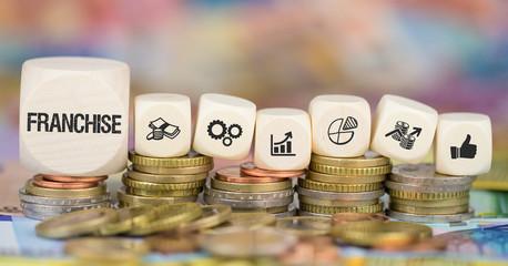 Franchise / Münzenstapel mit Symbole