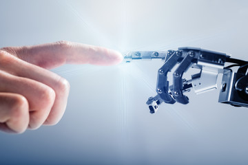 Businessperson's Finger Touching Robotic Finger