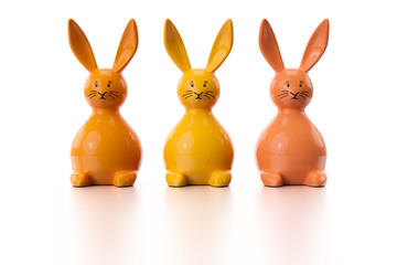 three orange easter bunny figures