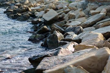 Photo of sea shore, large stones