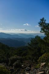 Photo against sun of mountain landscape