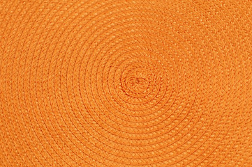 A colored mat made of rope twirled into a spiral.