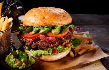 Large gourmet burger with avocado and guacamole