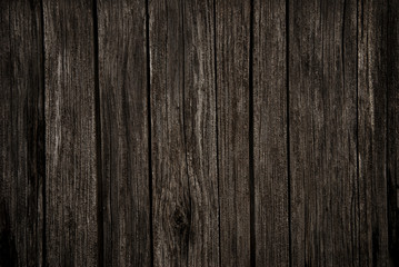 Old rich dark wood grain texture background with knots.