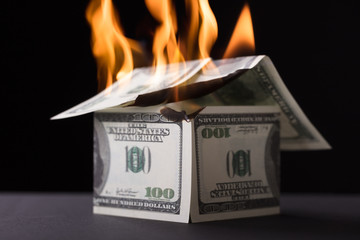 House Made Up Of Banknote Burning In Fire