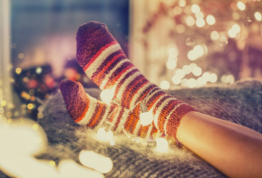 Woman near fireplace with socks