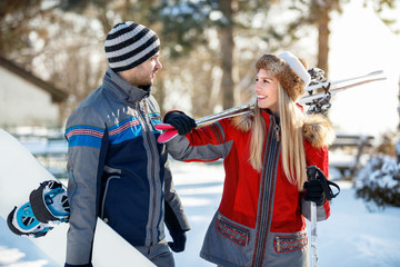 Man and woman in love with ski equipment