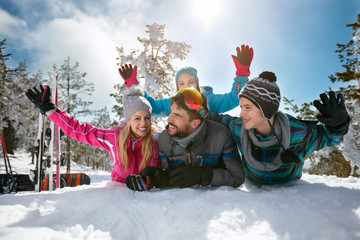 family on ski holiday having fun