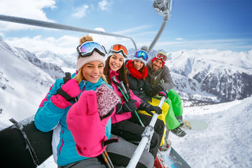 friends skiers enjoying in the slopes at winter vacations and making selfie