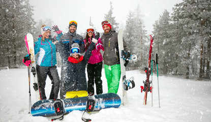 Group of smiling friends snowboarders having fun