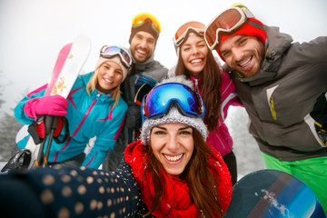Group of friends having fun on winter hodays and making selfie