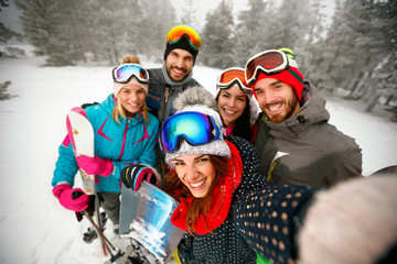 winter, extreme sport and people concept - friends having fun on winter hodays