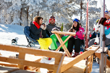 friends spending time together in cafe at ski resort