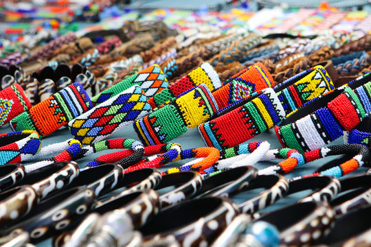 Colorful handmade bracelets, bangles at local craft market in South Africa