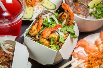 Assorted Chinese food set. Chinese noodles, fried rice, dumplings, peking duck, dim sum juice