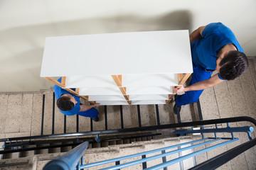Two Men Carrying Shelf