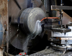 Granite is shaped on a lathe to make a curling stone in Kays Factory Mauchline, Scotland