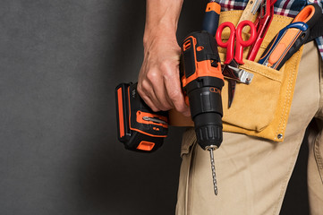 Hand holding construction tools