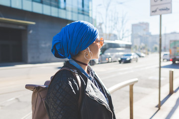 portrait arabian young woman wearing hijab outdoor listening music