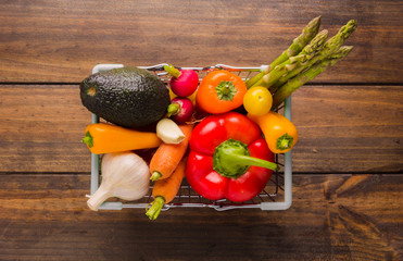 Composition with different types of vegetables on a wooden table.