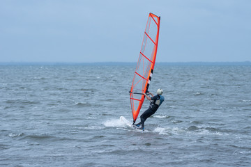 Man wind surfing in the ocean outside the Swedish east coast