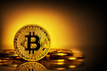 Virtual currency bitcoin on yellow background