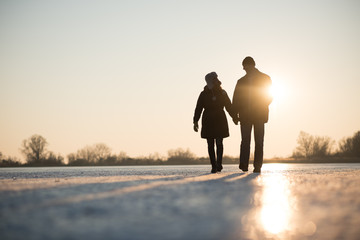 Love couple walking while holding hands