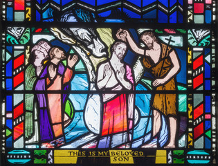 LONDON, GREAT BRITAIN - SEPTEMBER 16, 2017: The Babtism of Jesus cene on the stained glass in church St Etheldreda by Charles Blakeman (1953 - 1953).